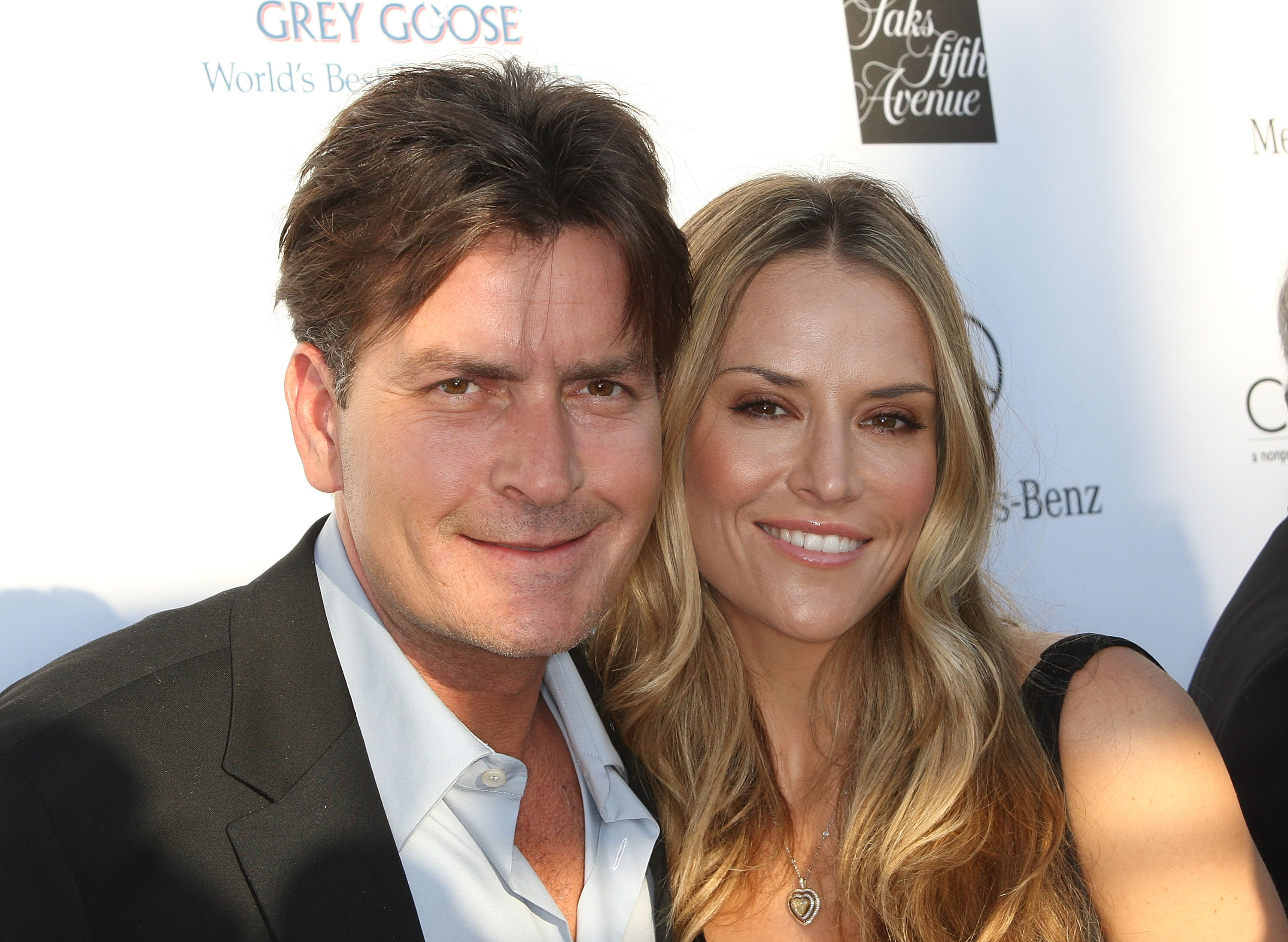 Charlie Sheen shows off his new wife, Brooke Mueller