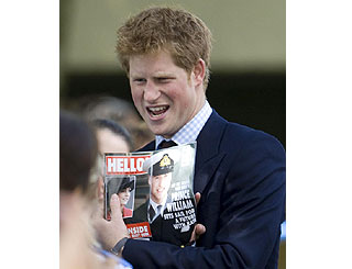Harry shows off HELLO! with Wills on cover