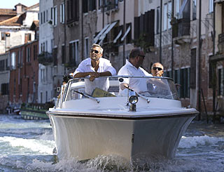 George cruises into Venice by water taxi