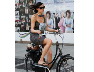 Famke Janssen takes a bike out of the Big Apple