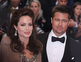 Angelina and family return to US for premiere