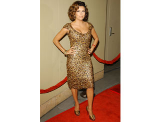 Eva Longoria shimmers in gold for gala