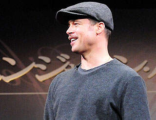 Flat cap delivers cloak of invisibility for Brad Pitt