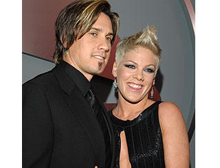 Pink returns to arms of ex husband Carey
