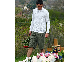 Jade's widower Jack lays roses at her resting place