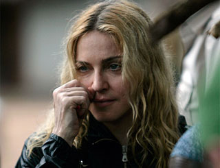 Strain of adoption rejection takes toll on Madonna