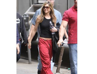 Jennifer Aniston glam as ever in tee and cargos on Baster set