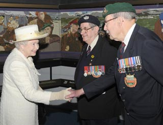Queen and Prince Philip meet D-Day veterans at museum