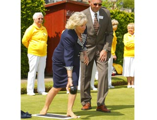 Camilla sheds shoes for maiden try at bowls