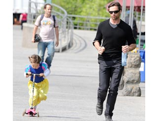Hugh Jackman kept on his toes by scooter girl Ava