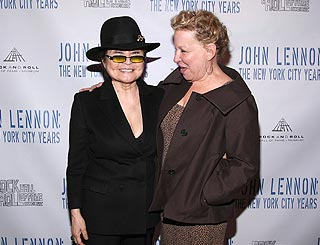 Yoko supported by pal Bette Midler at Lennon expo opening