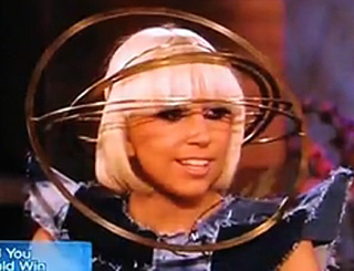 Lady GaGa dons wacky headgear for US chat show