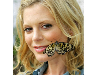 Emilia Fox receives butterfly kiss as she inspects faux rainforest