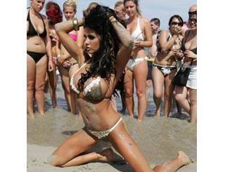 Katie Price returns to alter ego Jordan as she models in Ibiza