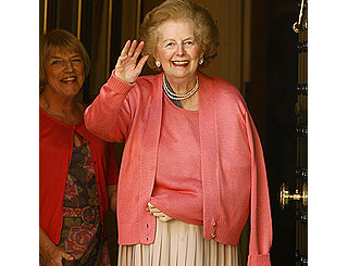 A beaming Margaret Thatcher returns home from hospital