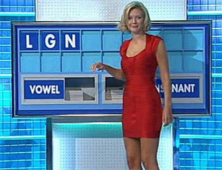 Countdown new girl Rachel Riley turns up the heat in red mini