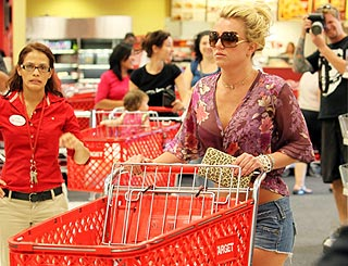 Canny Britney picks out bargains at a discount store