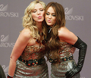 Kim Cattrall holds her own in same dress as Miley