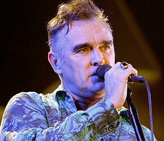 Morrissey rushed to hospital after collapsing on stage
