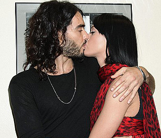Russell's congratulatory kiss from new love Katy Perry