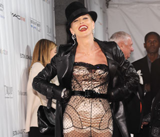 Bold Sharon Stone wears leather and lace to benefit