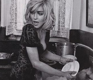 Madonna as you've never seen her – doing the dishes