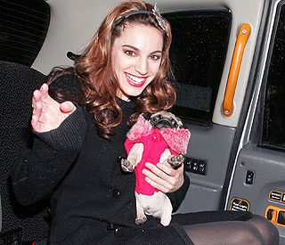 It's puppy love for Kelly Brook and her new pal