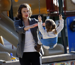 Milla Jovovich and daughter have play date in the park