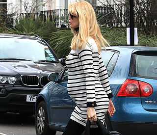 Claudia Schiffer takes burgeoning bump on school run