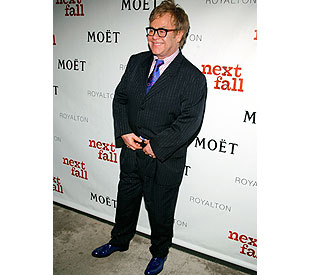 Elton John auctions 100 pairs of shoes for charity