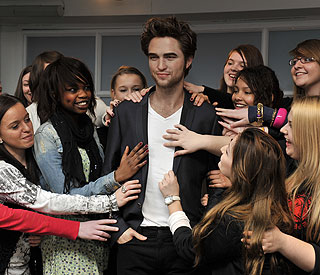 Delighted fans get their hands on Robert Pattinson