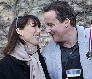 David Cameron using wife's pregnancy to 'eat a lot'