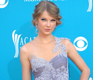 Country music star Taylor Swift happy to be single