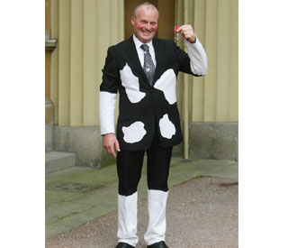 Queen awards MBE to milkman dressed as cow