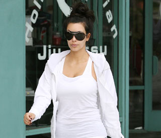 No longer single, Kim Kardashian hits the gym