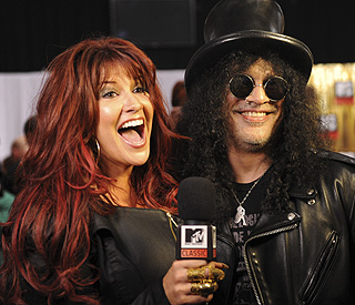 Musician Slash files for divorce from wife Perla