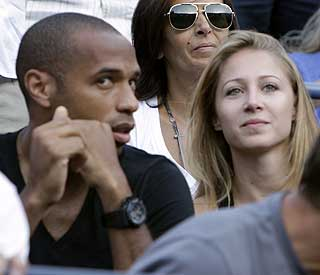 Love match: Thierry Henry and girlfriend take in tennis