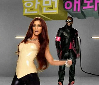 Cheryl Cole dons latex leggings for Will.i.am cameo