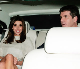 Simon Cowell's hols with Sinitta as fiancée stays home