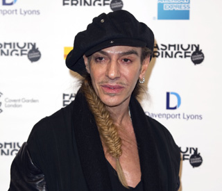 Suspended John Galliano denies racism claims