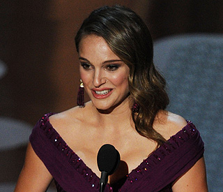 Natalie Portman swans off with best actress trophy