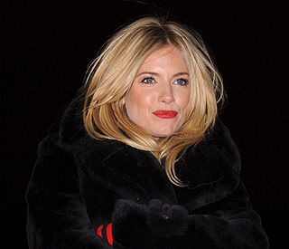 'I'm single!' insists Sienna Miller