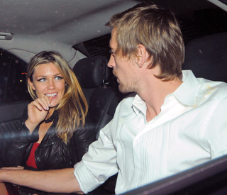 Pride of new parents Abbey Clancy and Peter Crouch