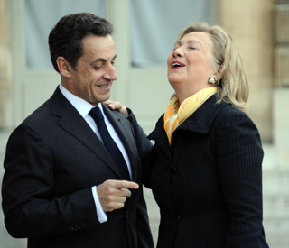 President Sarkozy has Hillary Clinton in giggles