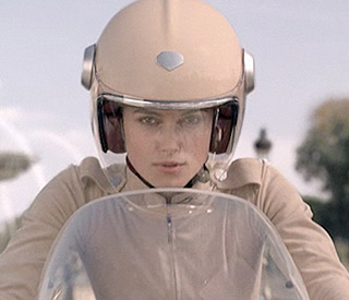 Keira Knightley gets on her bike for sexy Chanel ad