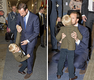 Prince Haakon calms his boisterous son with a kiss