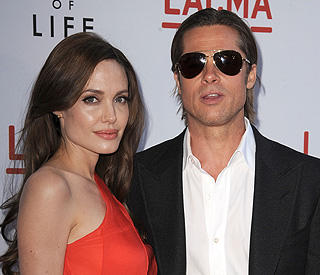 Brad Pitt and Angelina Jolie won't wed this summer