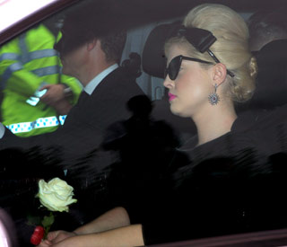 Mark Ronson and Kelly Osbourne at Amy's funeral