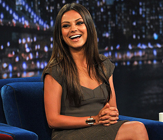 Mila Kunis likes men who can make her laugh