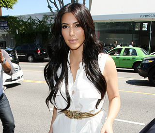 Bride Kim Kardashian attends final dress fitting